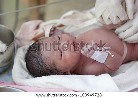 New born baby in doctor's hands