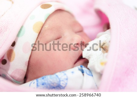 New born baby infant asleep in the blanket - stock photo