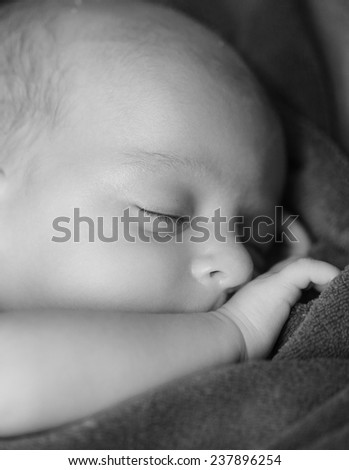 New born baby is sleeping over blanket. - stock photo