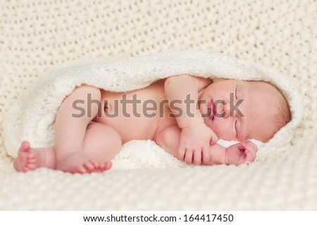 New born baby portrait, lying in blanket