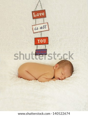new born baby sleeping in just an Easter chick hat - stock photo