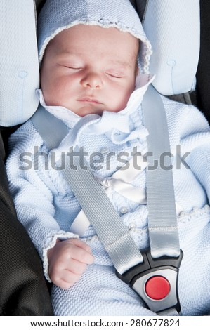 New born in the car using seat belt - stock photo