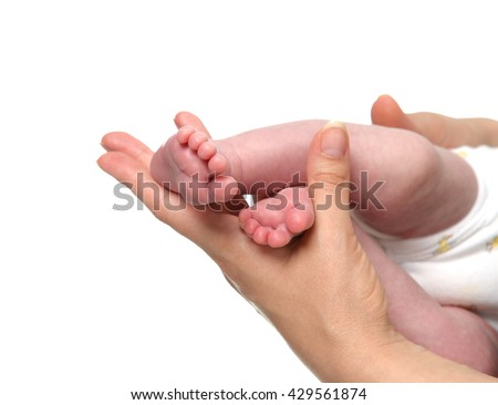 New born infant baby feet in mother hands. Mom and Child. Healthy medical concept. Beautiful conceptual image of Maternity - stock photo