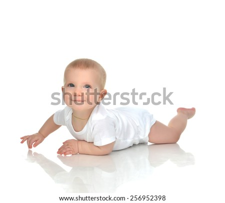New born 8 month infant child baby boy lying happy smiling on a white background