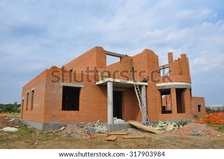 New brick building house construction with doorway columns - stock photo