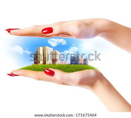 New buildings in woman hands. On white background. - stock photo