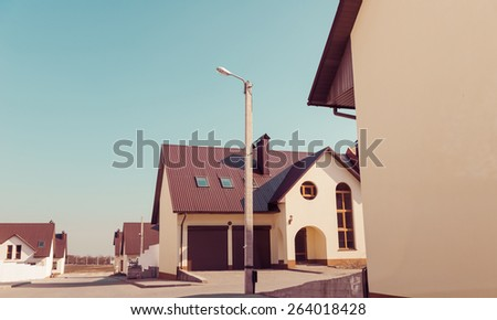 new built homes corners at uptown street - stock photo