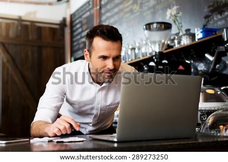 New business owner counting revenue - stock photo