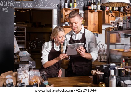 New business owners using tablet - stock photo