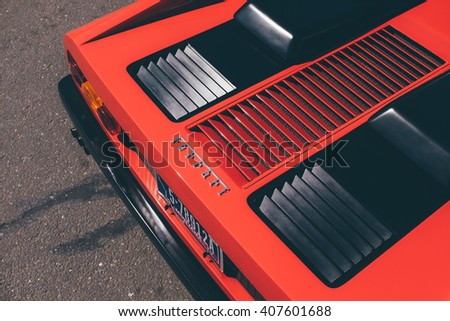 New Canaan,CT - April 17 2016: At a free public car show in New Canaan, rear ventilation of a classic Ferrari in red and black. - stock photo