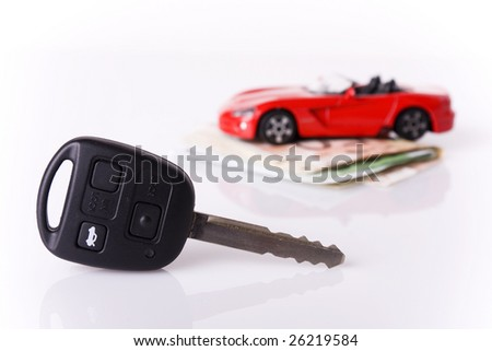 New car Concept - Key and a red car with euro banknotes (selective focus on the key) - stock photo