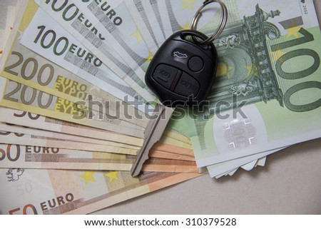 New Car key and Euro banknotes