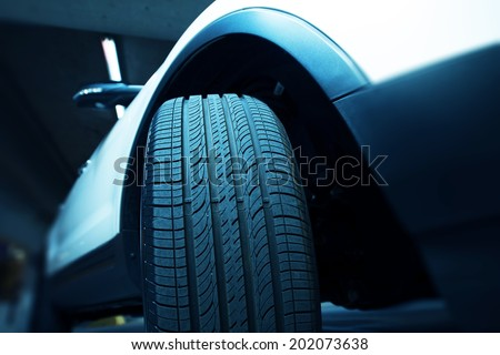 New Car Tire - Car Wheel Closeup. - stock photo