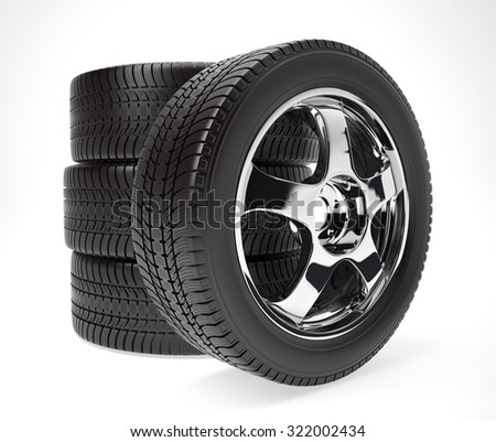 New car wheel with winter tire stacked up and isolated on white background