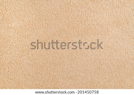 New carpet texture. Bright Beige carpet flooring as seamless background, top view - stock photo