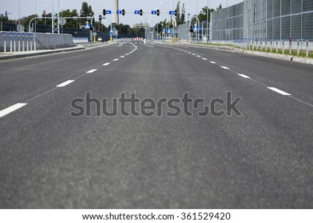 New city bypass road empty from cars - stock photo