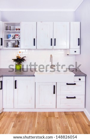 New classic-look kitchen in modern rustic style in Krakow, Poland - stock photo