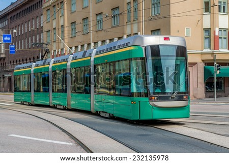 New clean tram with five cars on the Heslinki street.