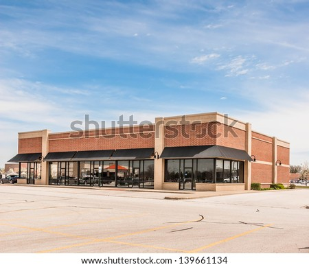 New Commercial, Retail and Office Space available for sale or lease. Strip Mall. Commercial office building - stock photo
