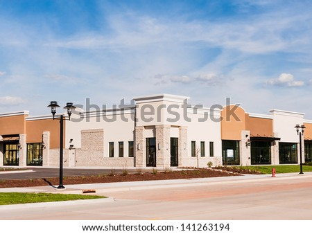 New Commercial, Retail and Office Space available for sale or lease. Strip Mall. Modern commercial office building. - stock photo