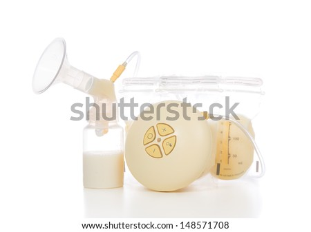 New compact electric breast pump to increase milk supply for breastfeeding mother and child feeding bottle with breastmilk isolated on white background - stock photo