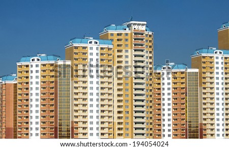 New constructed buildings over clear cloudless blue sky