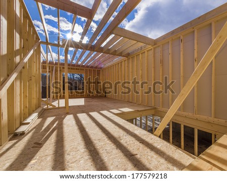 New construction of a house/Framed New Construction of a House/Building a new house from the ground up  - stock photo