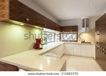 New contemporary kitchen interior in green colors - stock photo