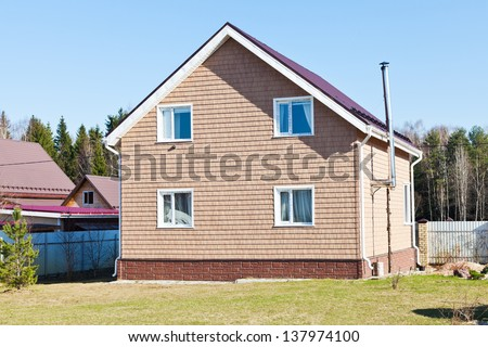 new country cottage in spring day - stock photo