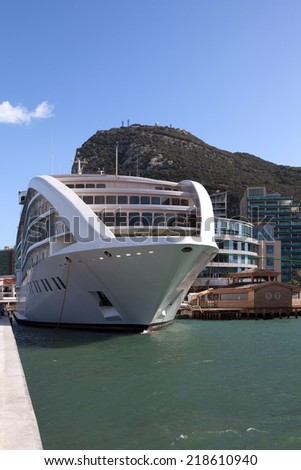 New cruiseship moored at Gibraltar marina; Rock of Gibraltar in the background - stock photo