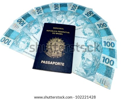 New currency from Brazil and brazilian passport - stock photo