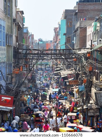 NEW DELHI, INDIA - APRIL 09: Chandni Chowk, originally meaning moonlit market, is one of the most historic (17th century) and busiest markets in India on April 09, 2012 in New Delhi. - stock photo