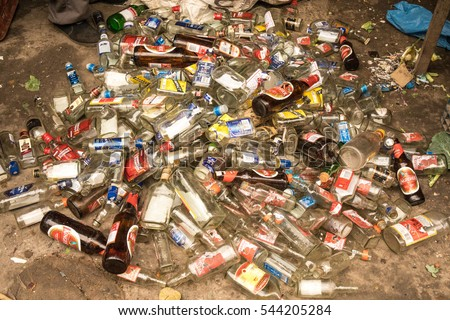 NEW DELHI, INDIA - DECEMBER 26, 2016: Empty wine and beer bottles are dumped on a garbage pile after a new year's party