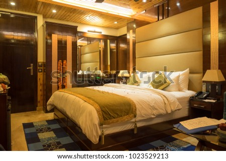 New Delhi, India - December 19 2015: Hotel room with large bed in a New Delhi hotel.