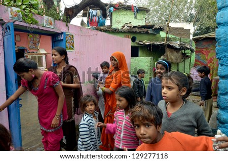NEW DELHI,INDIA-FEBRUARY 4 : a group of mothers and children living in the slums of New Delhi, on February 4,2013. In India dramatically increases the number of poor - stock photo
