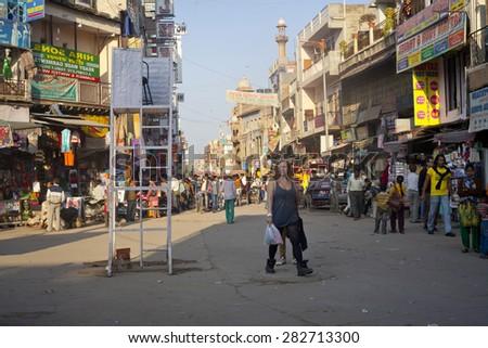 NEW DELHI, INDIA - FEBRUARY 15: Busy Indian Street Market, famous Main Bazaar, on February 15, 2013 in New Delhi, India.  - stock photo
