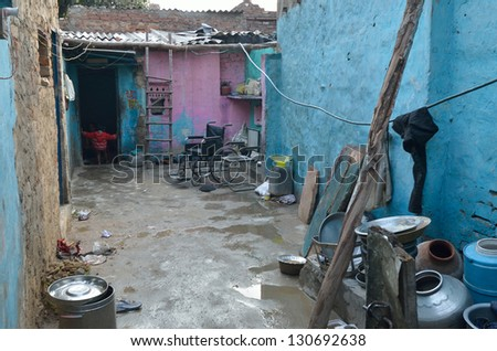 NEW DELHI,INDIA-FEBRUARY 4 : courtyard of a house in the poor neighborhood of New Delhi in February 4,2013. In New Delhi dramatically increases the number of poor people living in slums - stock photo