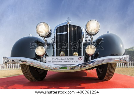 New Delhi, India - February 6, 2016: Front low angle view of beautiful vintage retro saloon Maybach SW38C (1937 model). The Maybach was a German car manufacturer and the company founded in 1909. - stock photo
