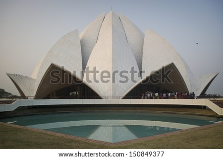 NEW DELHI, INDIA - NOV 8: Lotus Temple at sunset on November 8, 2012, New Delhi, India. The Bahai House of Worship in New Delhi, popularly known as the Lotus Temple due to its flowerlike shape