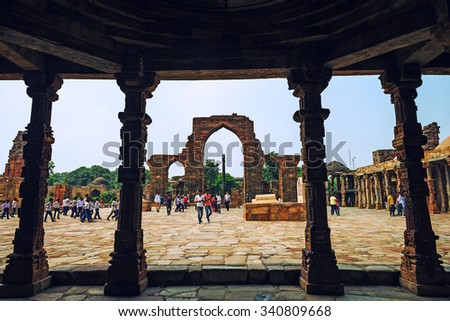 NEW DELHI, INDIA - SEPTEMBER 19: Qutab Minar on September 19, 2015 in New Delhi, India. The famous Iron Pillar is one of the most curious wonder of the world. - stock photo