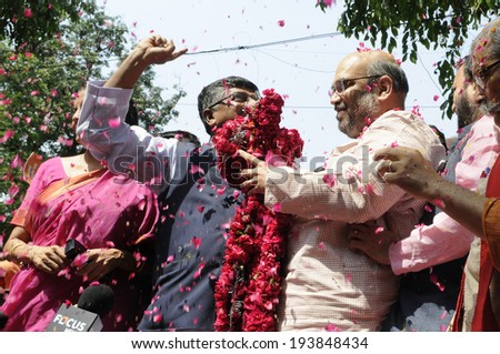 NEW DELHI-MAY 16:  Amit Shah the general secretary of the BJP  being garlanded by Ravi Shankar Prasad  after BJP won the Indian National election on May 16, 2014 in New Delhi , India.