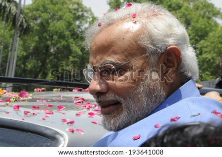 NEW DELHI-MAY 17: Indian Prime Minister Narendra Modi looking towards the waiting crowd  during a roadshow  after wining the Indian National election on May 17, 2014 in New Delhi , India. - stock photo