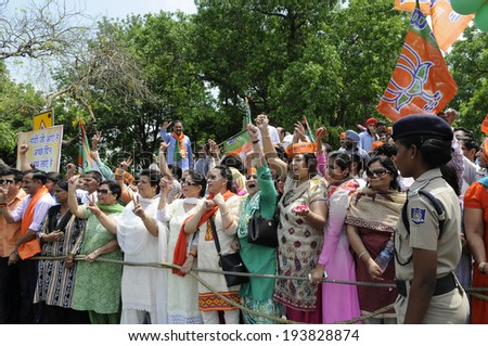 NEW DELHI-MAY 17:  Women BJP supporters chanting slogans during a rally after wining the Indian National election on May 17, 2014 in New Delhi , India.