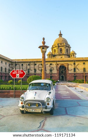 NEW DELHI - OCT 16: Official Hindustan Ambassador cars park outside North Block, Secretariat Building, on October 16, 2012 in Delhi, India. The production started in 1958 on base of the Morris model. - stock photo