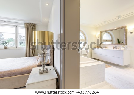 New design interior with stylish bedroom and light new design bathroom