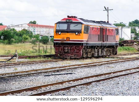 New diesel electric locomotive in the railway yard of tank farm. - stock photo
