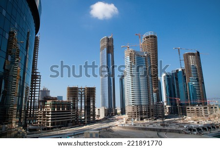 New District Rising - Construction of new buildings - skyscrapers, business buildings, hotels, apartments. Abu Dhabi, UAE.