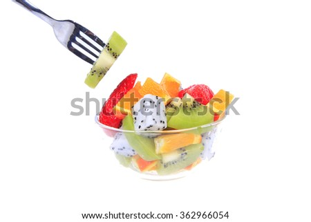 New dragon fruit, kiwi and oranges, consisting of a fruit salad