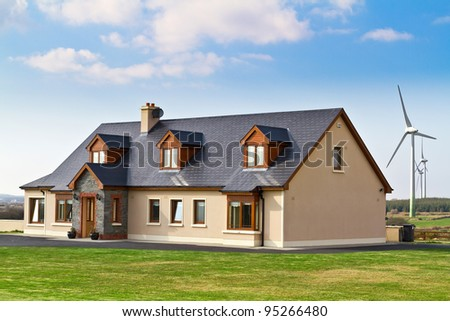 New ecology house with wind turbines - stock photo