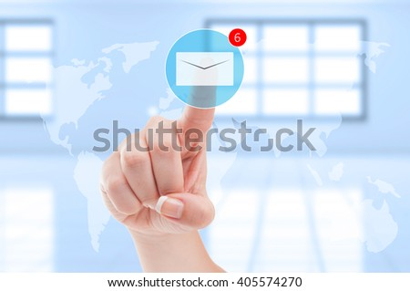 New emails inbox futuristic concept with finger pressing digital envelope on transparent digital display screen - stock photo